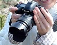 Ar konkursā laimētu fotoaparātu