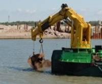 Огромный камень не помешает углублению порта