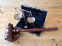 Бывшие работники ГПСС за получение взятки приговорены к реальному лишению свободы